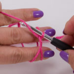 Now hook the thread above again and pull it through the loop on the hook.