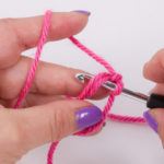 Insert the crochet hook into the ring from above...