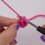 To close the ring, pierce the first single crochet (UK: double crochet) and pull through the thread.