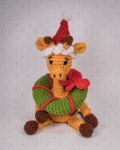 Giraffe Glenn has found another use for the mini wreath...