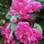 Ulrike's Mini Rosalie is hiding among the peonies.